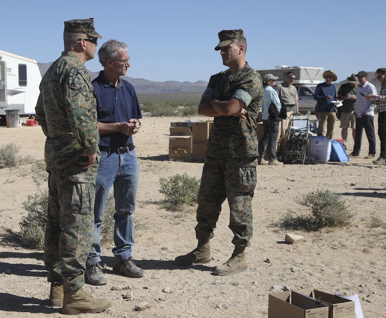Dr. Brian Henen, base ecologist, Natural Resources and Environmental Affairs, explains the desert tortoise's behavior to the Commanding General, Brig. Gen. William F. Mullen III, April 12, 2017, during the Desert Tortoise translocation aboard the Marine Corps Air Ground Combat Center, Twentynine Palms, Calif. The translocation, in accordance with the U.S. Fish and Wildlife Service-signed Biological Opinion, serves as a negotiated mitigation to support the mandated land expansion which will afford the Combat Center the ability to conduct Large Scale Exercise training featuring up to a Marine Expeditionary Brigade-level force. (U.S. Marine Corps photo by Lance Cpl. Natalia Cuevas)