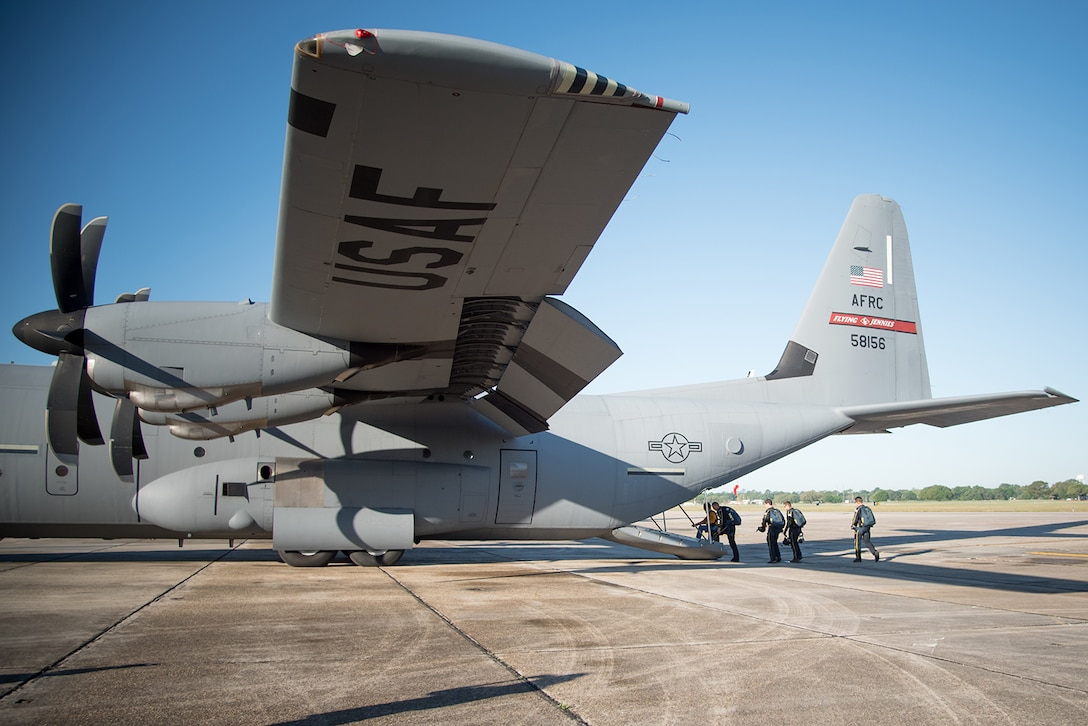 Members of the U.S. Navy Leap Frogs, and Gulfport, Miss. Mayor Billy Hewes, board an 815th Airlift Squadron C-130J Super Hercules aircraft for a jump April 4, 2017. The Leap Frogs coordinated with the Flying Jennies to complete this jump, and several others, out of Keesler Air Force Base, Miss. as joint training for both groups, which was also in conjunction with Navy Week and the Mississippi bicentennial celebration. (U.S. Air Force photo/Staff Sgt. Heather Heiney)