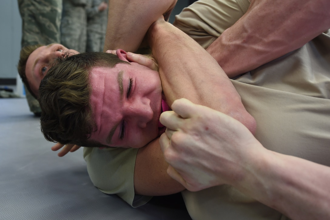 Senior Airman Matthew Timmons, a 673rd Security Forces Squadron member, attempts to break a hold during combatives training on Joint Base Elmendorf-Richardson, Alaska, April 4, 2017. Maintaining proficiency in hand-to-hand combat allows defenders to take control of situations where drawing a weapon might not be an option. (U.S. Air Force photo/Staff Sgt. Westin Warburton)