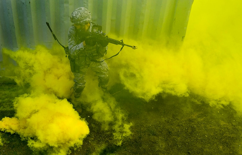 A student of the 435th Security Forces Squadron's Ground Combat Readiness Training Center's Security Operations Course is surrounded by smoke during the urban operations portion of the course on U.S. Army Garrison Baumholder, Germany, April 4, 2017. The students also performed mounted and dismounted operations. (U.S. Air Force photo/Senior Airman Tryphena Mayhugh)