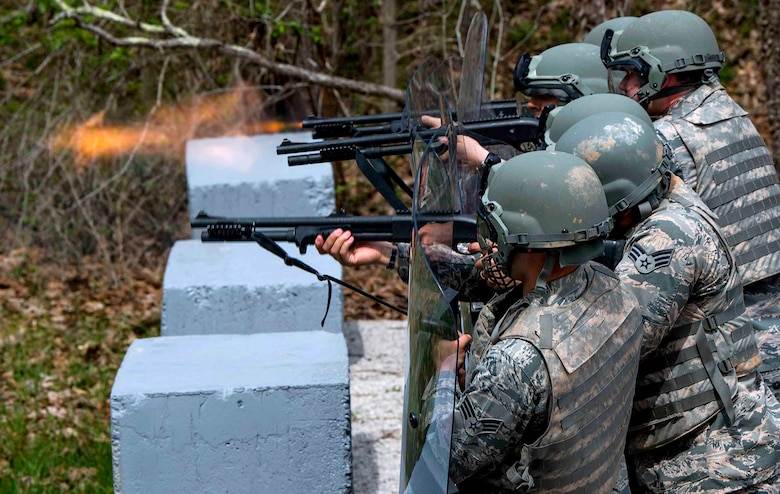 Defenders from the 130th Security Forces Squadron at McLaughlin Air National Guard Base, W.Va. practice firing non-lethal rounds, which consist of rubber bullets, during riot control training April 5, 2017, at Camp Virgil Tate, W.Va. Security forces personnel participated in training that exposed them to numerous scenarios they may encounter during their duties as military police. (U.S. Air National Guard Photo/Tech. Sgt. De-Juan Haley)