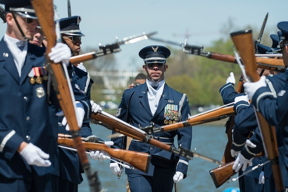 Tech. Sgt. Brian Kocher, a member of the U.S. Air Force Honor Guard Drill Team, walks through a double row of spinning rifles and bayonets during the Joint Service Drill Team Exhibition April 8, 2017, at the Jefferson Memorial in Washington, D.C. Drill teams from all four branches of the armed forces and the Coast Guard competed in a display of skills celebrating U.S. military heritage at the National Cherry Blossom Festival. (U.S. Air National Guard Photo/Staff Sgt. Christopher S. Muncy)
