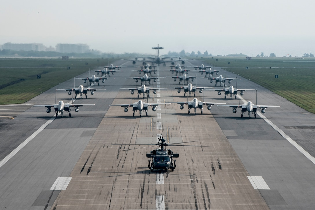 Fully armed Aircraft from the 18th Wing conduct an elephant walk during a no-notice exercise April 12, 2017, at Kadena Air Base, Japan. The 18th Wing operates combat ready fleets of HH-60 Pave Hawks, F-15 Eagles, E-3 Sentries and KC-135 Stratotankers, making it the largest combat-ready wing in the U.S. Air Force.(U.S. Air Force photo/Senior Airman John Linzmeier)