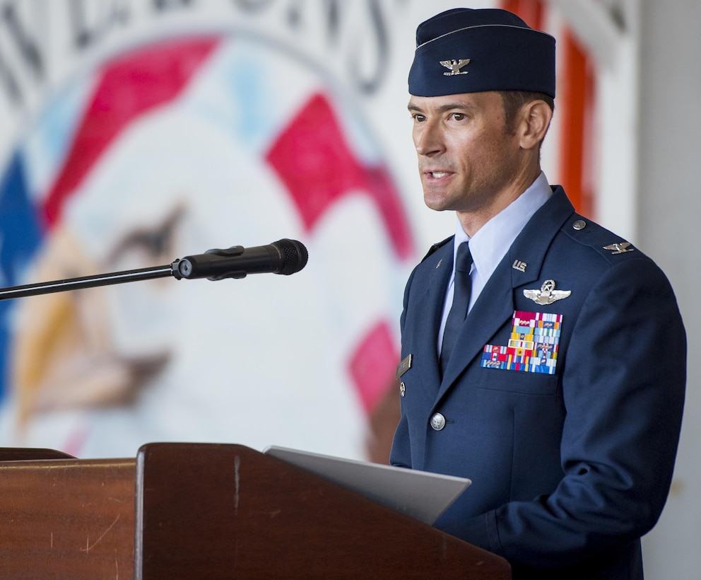 Col. Paul Moga speaks to the crowd and his Airmen after taking command of the 33rd Fighter Wing during a ceremony at Eglin Air Force Base, Fla., April 13.  Col. Lance Pilch relinquished command of the training wing to Moga.  (U.S. Air Force photo/Samuel King Jr.)