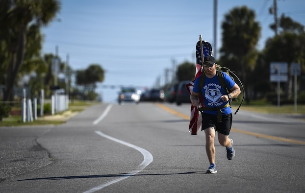 Tech. Sgt. Doug Iredale, a special missions aviator with the 4th Special Operations Squadron, marches in the 6th Annual Air Commando Ruck March at Panama City Beach, Fla., April 13, 2017. The Air Commando Ruckers marched 450 miles from MacDill Air Force Base, to Hurlburt Field. (U.S. Air Force photo by Airman 1st Class Joseph Pick)