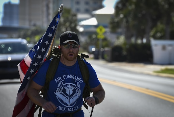 Tech. Sgt. Doug Iredale, a special missions aviator with the 4th Special Operations Squadron, marches in the 6th Annual Air Commando Ruck March at Panama City Beach, Fla., April 13, 2017. This year's ruck march is dedicated to the Air Commandos assigned to the 27th Special Operations Wing at Cannon Air Force Base, New Mexico, who perished March 14 in a U-28 crash. (U.S. Air Force photo by Airman 1st Class Joseph Pick)
