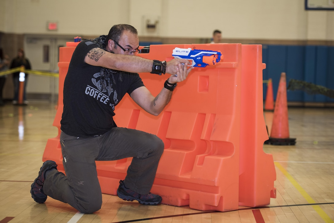 Cesar Diaz, Red River Hospital military hereos unit case manager and therapist, participates in the Sheppard Air Force Base, Texas, Family Advocacy Nerf night, April 13, 2017. The Nerf night was held to encourage families to unplug from electronic devices and spend time bonding as families. (U.S. Air Force photo by Staff Sgt. Kyle E. Gese)