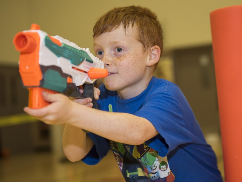 Keegan Macveigh, son of Master Sgt. Erich Marquardt and Airman 1st Class Katrina Marquardt, participates in the heated Nerf night at Sheppard Air Force Base, Texas, April 13, 2017. The Nerf night was held to encourage families to unplug from electronic devices and spend time bonding as families. (U.S. Air Force photo by Staff Sgt. Kyle E. Gese)