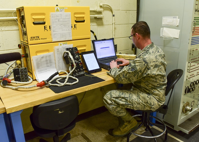 Senior Airman Mark Lee, an Electrical and Environmental craftsman assigned to the 28th Maintenance Squadron, troubleshoots an electrical component from a B-1 bomber using the state-of-the-art ECLYPSE tester inside the E&E back shop at Ellsworth Air Force Base, S.D., April 12, 2017. This state of the art tester has cut the troubleshooting process time for a part from 10 hours to 10 minutes. (U.S. Air Force photo by Airman 1st Class Randahl J. Jenson)