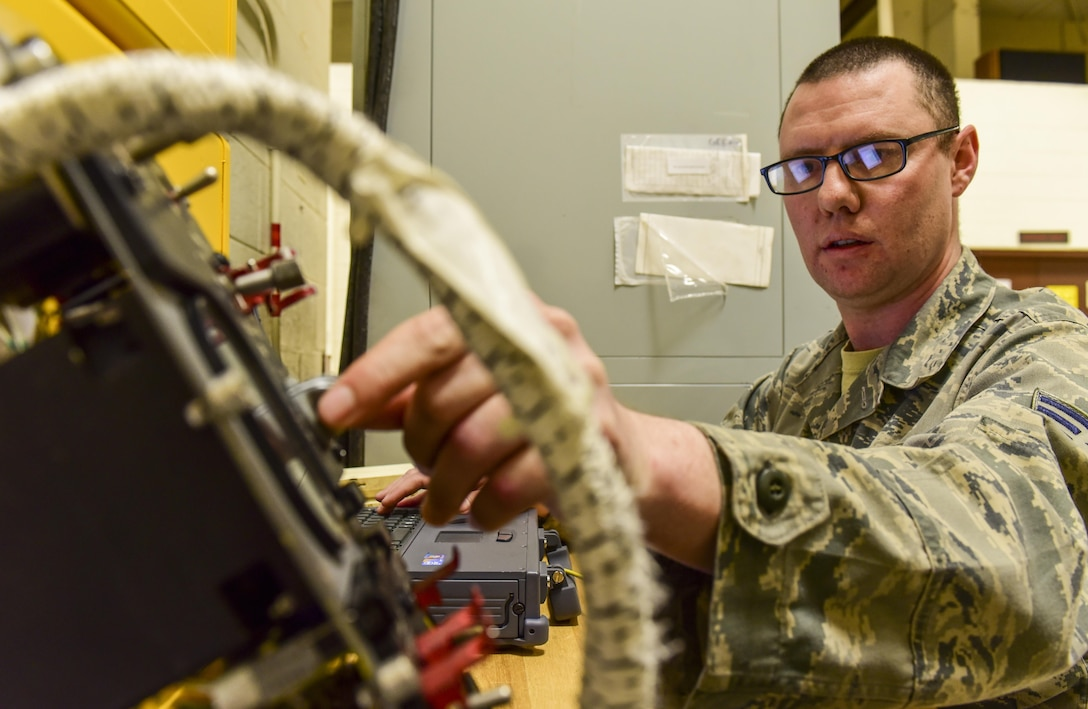 Senior Airman Mark Lee, an Electrical and Environmental craftsman assigned to the 28th Maintenance Squadron, makes adjustments while troubleshooting an electrical component from a B-1 bomber inside the E&E back shop at Ellsworth Air Force Base, S.D., April 12, 2017. Airmen have been using the state-of-the-art ECLYPSE tester that has cut the troubleshooting process by nearly 98 percent. (U.S. Air Force photo by Airman 1st Class Randahl J. Jenson)