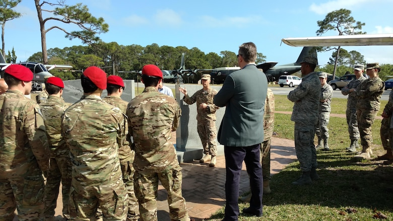 Lt. Col. Matthew Ziemann, the IW Department Chair for USAFSOS, leads an airpark tour at Hurlburt Field, Fla., March 28, 2017. The airpark tour was park of the Contemporary Irregular Warfare Course relating Air Force Special Operations Command aircraft to a lesson on airpower in irregular warfare. (Courtesy Photo)