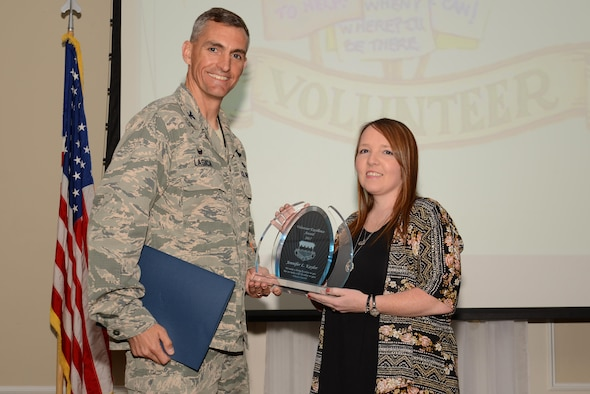 U.S. Air Force Col. Daniel Lasica, 20th Fighter Wing commander, presents Jennifer Kaylor, 20th Aircraft Maintenance Squadron Key Spouse and Shaw's Attic coordinator, the 2017 Volunteer Excellence Award at Shaw Air Force Base, S.C., April 13, 2017. Kaylor was recognized for her continuous contributions to the community, which benefitted Air Force and Army families. (U.S. Air Force photo by Airman 1st Class Kathryn R.C. Reaves)