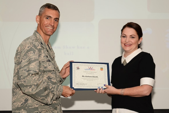 U.S. Air Force Col. Daniel Lasica, 20th Fighter Wing commander, presents Karlene Eberth, 20th Force Support Squadron McElveen Library Information and Learning Center volunteer, with a certificate of appreciation at Shaw Air Force Base, S.C., April 13, 2017. Eberth was recognized for her contributions to the library youth programs, such as summer and winter story times, and assistance to library aids which has saved the Air Force approximately $5,000 in salaries. (U.S. Air Force photo by Airman 1st Class Kathryn R.C. Reaves)