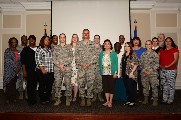 U.S. Air Force Col. Daniel Lasica, 20th Fighter Wing commander, center, stands with Team Shaw volunteers during a volunteer appreciation breakfast at Shaw Air Force Base, S.C., April 13, 2017. Volunteers contributed their time to organizations such as Shaw's Attic, Key Spouse Program, and youth sports and academic programs. (U.S. Air Force photo by Airman 1st Class Kathryn R.C. Reaves)