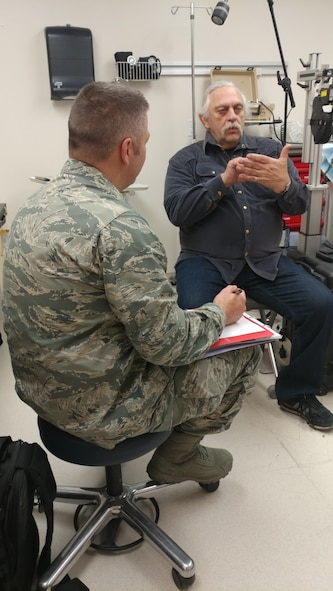 Air Force Major Brett Ringger, 136th Medical Group, Texas Air National Guard, provide eye exams to patients in a portable optometry clinic during ARCTIC CARE 2017, Port Lions, Alaska, on March 29, 2017. ARCTIC CARE 2017 is part of the Innovative Readiness Training program, which is an Office of Secretary of Defense sponsored civil-military collaboration intended to build on mutually beneficial partnerships between U.S. communities and the Department of Defense. ARCTIC CARE 2017 provides training opportunities for U.S. military (Active, Guard, Reserve) and Canadian Health service members to prepare for worldwide deployment while supporting the needs of underserved communities on Kodiak Island, Alaska. (U.S. Air Force photo by Tech. Sgt. Wendy Day)