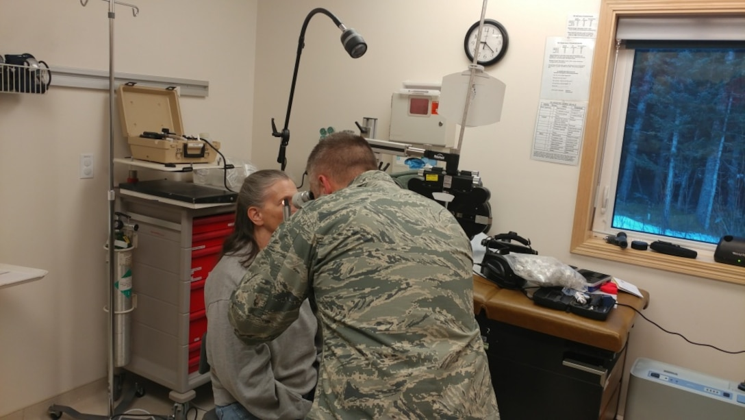 Air Force Major Brett Ringger, 136th Medical Group, Texas Air National Guard, provide eye exams in a portable optometry clinic during ARCTIC CARE 2017, Port Lions, Alaska, March 28, 2017. ARCTIC CARE 2017 is part of the Innovative Readiness Training program, which is an Office of Secretary of Defense sponsored civil-military collaboration intended to build on mutually beneficial partnerships between U.S. communities and the Department of Defense. ARCTIC CARE 2017 provides training opportunities for U.S. military (Active, Guard, Reserve) and Canadian Health service members to prepare for worldwide deployment while supporting the needs of underserved communities on Kodiak Island, Alaska. (U.S. Air Force photo by Tech. Sgt. Wendy Day)