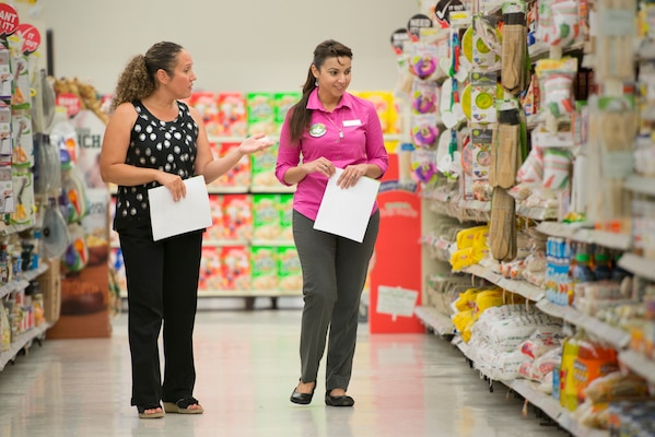 Aracelis Gonzalez-Anderson (left), Health Promotions Program coordinator, and Claudia Smith, Commissary store manager, discuss the available healthy food options April 11, 2017, at Joint Base San Antonio-Randolph Commissary. The Health Promotions Services offer resources on eating healthy and promote living a fit lifestyle to JBSA personnel.