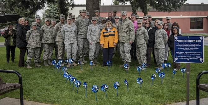Members of Team Fairchild gathered during the Pinwheels for Prevention event to raise awareness for Child Abuse Awareness Month Apr. 12, 2017, at Fairchild Air Force Base, Washington. For more than 30 years, America has acknowledged April as Child Abuse Awareness Month. Sweeping legislation throughout the 70s and 80s gave rise to the needed public awareness campaign. Despite these efforts, in 2014, the Center for Disease Control estimated over 1,500 children died from abuse and neglect in the United States. (U.S. Air Force photo/Airman 1st Class Sean Campbell)