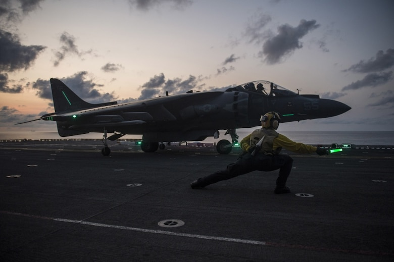 Aviation Boatswain™s Mate (Handling) 2nd Class Morgan Jackson, from Los Angeles, gives the signal for an AV-8B Harrier, assigned to the Ridge Runners of Marine Medium Tiltrotor Squadron (VMM) 163, to take off from the flight deck of the amphibious assault ship USS Makin Island (LHD 8), April 12, 2017. Makin Island, the flagship for the Makin Island Amphibious Ready Group, with the embarked 11th Marine Expeditionary Unit, is operating in the Indo-Asia-Pacific region to enhance amphibious capability with regional partners and to serve as a ready-response force for any type of contingency.