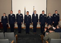 U.S. Air Force 2nd Lt. (left to right) Sarrah Williams, Ryan Wahl, Patrick Viau, Caleb Tolley, Makenna Ortiz, Kyle Lassiter, Amber Kosloske and Joseph Alcorn, graduated air battle manager training from the 337th Air Control Squadron at Tyndall Air Force Base, Fla., April 14, 2017. The 9-month ABM course teaches junior officers a diverse set of skills allowing them to direct airborne assets across a widespread range of combat operations. (U.S. Air Force photo by Airman 1st Class Isaiah J. Soliz/Released)