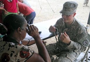 Spc. Braydon Berger, a combat medic assigned to Utah National Guard Medical Command, prepares to check vital signs on a local Belizean woman during a free medical event held in Ladyville, Belize, April 9, 2017, as a part of Beyond the Horizon 2017.  BTH 2017 is an on-going partnership exercise between the Government of Belize and U.S. Southern Command that will provide three free medical service events and five construction projects throughout the country of Belize from March 25 until June 17. (U.S. Army Photo by Staff Sgt. Fredrick Varney, 131st Mobile Public Affairs Detachment)