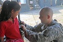 1st Lt. Dallin Peterson, a preventative medicine officer assigned to the Utah National Guard's 19th Special Forces Group, checks vitals on a young patient April 9, 2017, during a free medical event held in Ladyville, Belize as a part of Beyond the Horizon 2017.  BTH 2017 is an on-going partnership exercise between the Government of Belize and U.S. Southern Command that will provide three free medical service events and five construction projects throughout the country of Belize from March 25 until June 17. (U.S. Army Photo by Staff Sgt. Fredrick Varney, 131st Mobile Public Affairs Detachment)