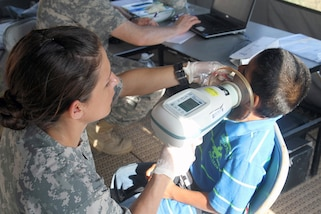 Sgt. Samantha Miller, a dental technician assigned to the Utah National Guard Medical Command, takes dental x-rays of a young patient April 9, 2017, during a free medical event held in Ladyville, Belize as a part of Beyond the Horizon 2017.  BTH 2017 is an on-going partnership exercise between the Government of Belize and U.S. Southern Command that will provide three free medical service events and five construction projects throughout the country of Belize from March 25 until June 17. (U.S. Army Photo by Staff Sgt. Fredrick Varney, 131st Mobile Public Affairs Detachment)