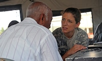 Sgt. Samantha Miller, a dental technician assigned to the Utah National Guard Medical Command, speaks with a local Belizean man about dental treatment April 9, 2017, during a free medical event held in Ladyville, Belize as a part of Beyond the Horizon 2017.  BTH 2017 is an on-going partnership exercise between the Government of Belize and U.S. Southern Command that will provide three free medical service events and five construction projects throughout the country of Belize from March 25 until June 17. (U.S. Army Photo by Staff Sgt. Fredrick Varney, 131st Mobile Public Affairs Detachment)