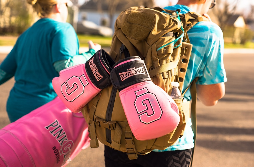 Women with Pink Gloves Boxing rucked with 40-pound ruck sacks during the 2017 Sexual Assault Awareness and Prevention 5k Ruck, Run, or Walk event on April 8, 2017 in Cheyenne, Wyoming.    This annual event is designed to bring awareness to sexual assault and show support to sexual assault victims. (Courtesy Photo by Daniel de La Fé)