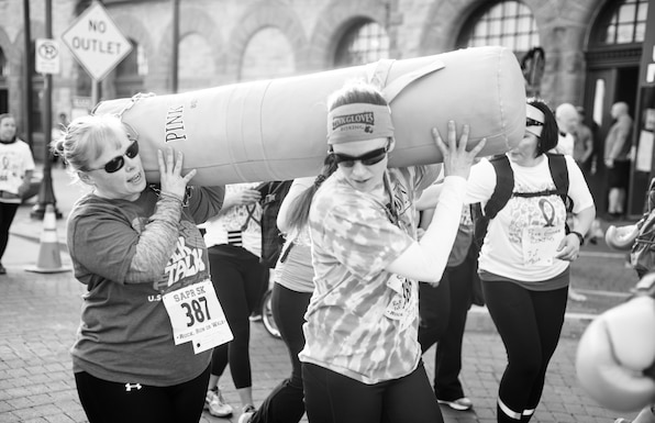 Women with Pink Gloves Boxing rucked with 40-pound ruck sacks during the 2017 Sexual Assault Awareness and Prevention 5k Ruck, Run, or Walk event on April 8, 2017 in Cheyenne, Wyoming.