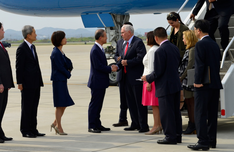U.S. Vice President of the United States Mike R. Pence and his wife, Karen Pence, greet Republic of Korea Vice Foreign Minister Lim, Sung-Nam at Osan Air Base, Republic of Korea, April 16, 2017. The visit, which marked the most senior member of the Trump administration to visit Korea, underscored how the long alliance between the U.S. and the ROK is a linchpin of peace and prosperity in the Asia-Indo-Pacific region and the commitment the U.S. government has to support its regional allies. (U.S. Air Force photo by Alex Fox Echols III)