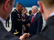 U.S. Vice President of the United States Mike R. Pence greets U.S. Army Gen. Vincent K. Brooks, United States Forces Korea commander, after landing at Osan Air Base, Republic of Korea, April 16, 2017. Pence's visit to Korea highlighted the importance of the U.S. – ROK alliance, and how teamwork will be vital to deterring regional threats and maintaining stability on the Korean peninsula. (U.S. Air Force photo by Staff Sgt. Alex Fox Echols III)