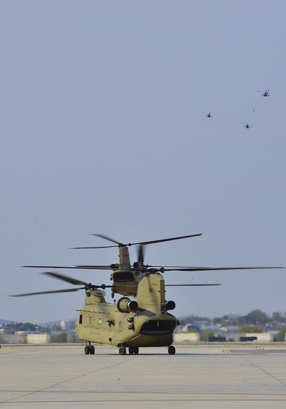 A group of helicopters depart from the flightline during Vice President of the United States Mike R. Pence's visit at Osan Air Base, Republic of Korea, April 16, 2017. The visit, which marked the most senior member of the Trump administration to visit Korea, underscored how the long alliance between the U.S. and the ROK is a linchpin of peace and prosperity in the Asia-Indo-Pacific region and the commitment the U.S. government has to support its regional allies. (U.S. Air Force photo by Airman 1st Class Gwendalyn Smith)