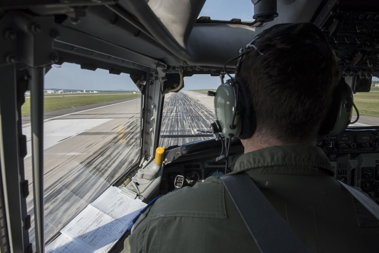 A U.S. Air Force E-3 Sentry pilot from the 961st Airborne Air Control Squadron prepares for takeoff March 28, 2017, at Kadena Air Base, Japan. In support of air-to-ground operations, the Sentry can provide direct information needed for interdiction, reconnaissance, airlift and close-air support for friendly ground forces. (U.S. Air Force photo by Senior Airman John Linzmeier/released)