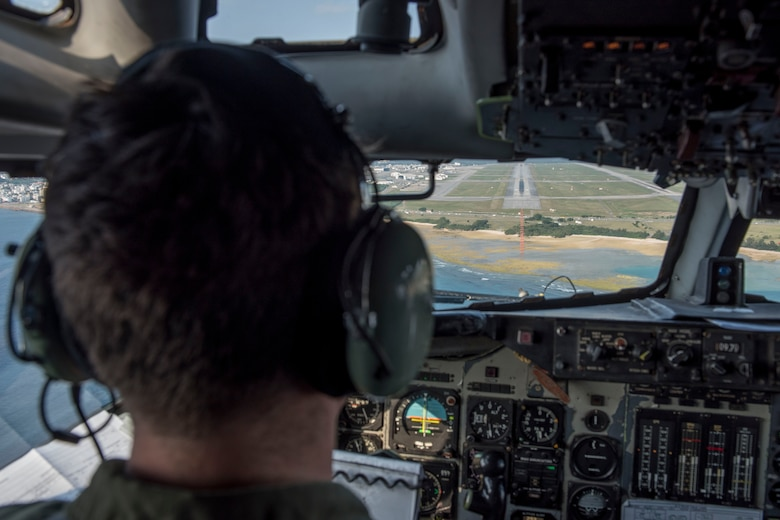 A U.S. Air Force pilot from the 961st Airborne Air Control Squadron approaches the runway of Kadena Air Base, Japan, March 28, 2017. In support of air-to-ground operations, the Sentry can provide direct information needed for interdiction, reconnaissance, airlift and close-air support for friendly ground forces. (U.S. Air Force photo by Senior Airman John Linzmeier/released)