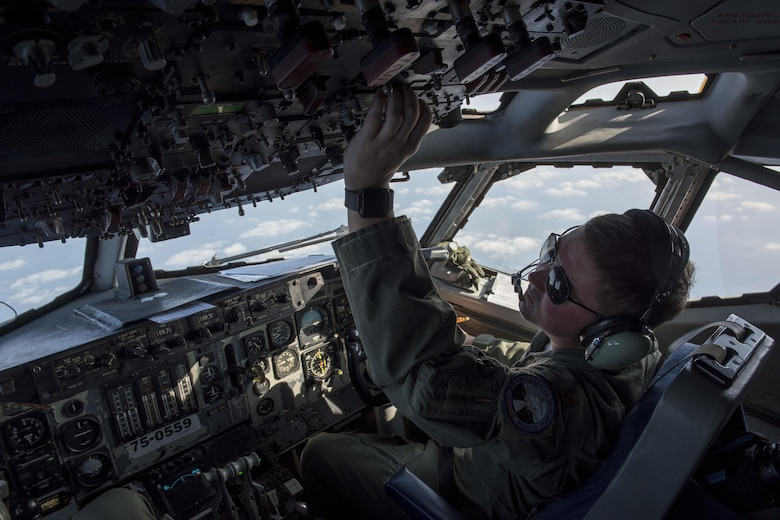 U.S. Air Force Maj. Victor Wadsley, 961st Airborne Air Control Squadron pilot, checks gauges on an E-3 Sentry March 28, 2017, over the Pacific Ocean. The radar and computer subsystems in the Sentry can gather and present broad and detailed battlefield information. (U.S. Air Force photo by Senior Airman John Linzmeier/released)