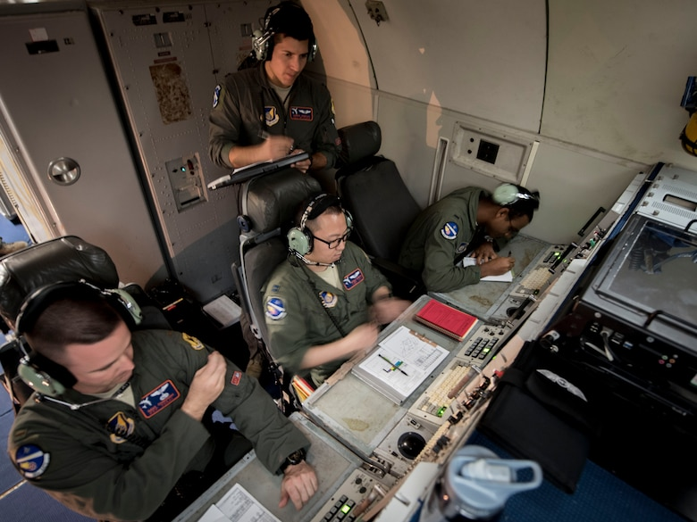 U.S. Air Force air weapons officers from the 961st Airborne Air Control Squadron communicate with F-15 Eagles from Kadena Air Base, Japan, March 28, 2017, during a training mission over the Pacific Ocean. The 961st conducts routine training with local fighter units to stay proficient at air combat operations. (U.S. Air Force photo by Senior Airman John Linzmeier/released)