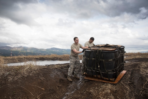 (Right to left) Airman 1st Class Dominic Pacheco, and Staff Sgt. William McAtee, both with the 374th Logistics Readiness Squadron combat mobility flight recovery team, pull a containerized delivery system bundle at Combined Armed Training Center Camp Fuji, Japan, April 12, 2017. Airmen with the 374th Logistics Readiness Squadron and Eagle airlifts with the 36th Airlift Squadron conducted mass CDS airdrop training. (U.S. Air Force photo by Yasuo Osakabe)