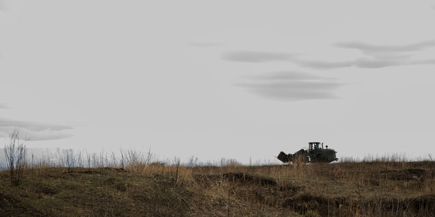 A marine assigned to the Combined Armed Training Center Camp Fuji drives a 10k adverse terrain forklift at CATC Camp Fuji, Japan, April 12, 2017. U.S. Marines supported to recovery mass containerized delivery system bundles, which dropped from a U.S. Air Force C-130H Hercules, assigned to the 36th Airlift Squadron. (U.S. Air Force photo by Yasuo Osakabe)