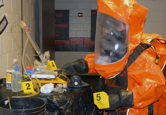 2nd Civil Support Team (CST) member Staff Sgt. Joshua Spagnola uses evidence markers to tag suspected hazardous materials in a mock WMD laboratory during the 2nd CST's training exercise at Joseph L. Bruno Stadium in Troy, N.Y. on April 12, 2017. Team members are trained to identify chemical, biological, and radiological agents and advise first-responders on how to deal with these materials.