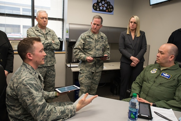 Hanscom Collaboration and Innovation Center Operations Analyst, 1st Lt. Kyle Palko, presents hardened electronic flight bag applications, submitted by private firms, to Air Force Life Cycle Management Center Commander Lt. Gen. John Thompson and U.S. Air Force Chief of Staff, Gen. David L. Goldfein March 28, 2017. Also on hand are EFB PlugTest Program Manager Brittany Ridings and Master Sgt. Benjamin Lewis, Air Mobility Command loadmaster and EFB program expert. Goldfein toured the HCIC and underscored the importance of multi-domain connectivity during his March 28-30 tour of Hanscom. (U.S. Air Force photo/Mark Herlihy)