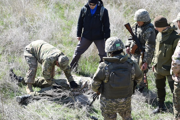 Sgt. 1st Class Javier Martinez, 6th Squadron, 9th Cavalry Regiment, U.S. Army, demonstrates how to search an enemy soldier wounded in action Apr. 9, 2017, during the practical exercise scenarios for Steppe Eagle Koktem at Illisky Training Center, Kazakhstan.