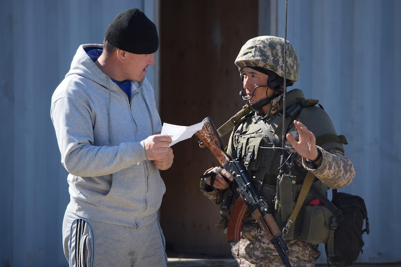 A Kazakhstani soldier practices civil military operations with a citizen role player during a Steppe Eagle Koktem scenario Apr. 10, 2017, at Illisky Training Center, Kazakhstan. Civil Military operations are critical tasks in peacekeeping operations.