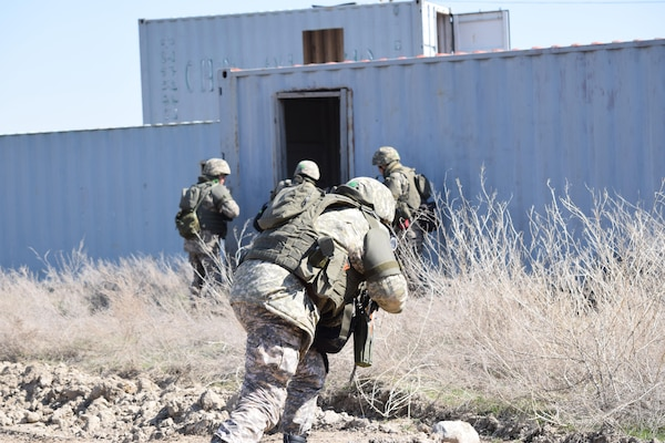 A Kazakhstani soldier runs toward cover during a cordon and search scenario for Steppe Eagle Koktem Apr. 10, 2017, at Illisky Training Center, Kazakhstan.