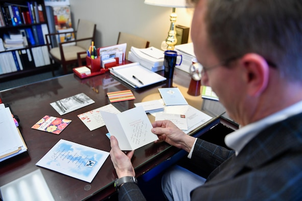 Brad Stanley, 628th Air Base Wing Office of the Staff Judge Advocate Civil Law division chief, reads a thank you note from a person he helped go through the naturalization process here, April 13, 2017. Members of 628th ABW JA have assisted more than 300 service members and their families receive their citizenship since the Joint Base Charleston Immigration Clinic was created in 2008.