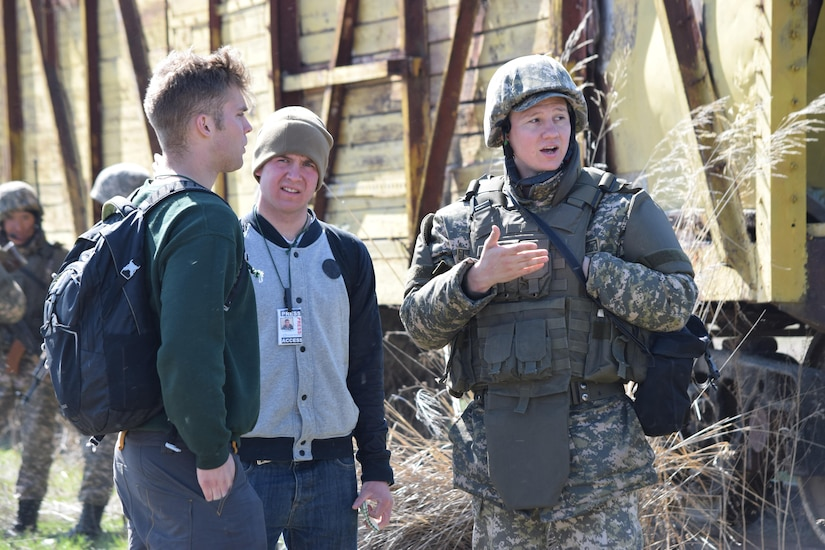 A Kazakhstani soldier from the Kazakhstan Peacekeeping Battalion escorts two media embed role players during a peacekeeping operations scenario for Steppe Eagle Koktem Apr. 10, 2017, at Illisky Training Center, Kazakhstan.