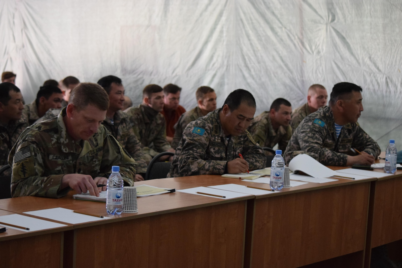 Officials from the U.S. Army, British Army and the Armed Forces of Kazakhstan listen to an after action review on the last day of Steppe Eagle Koktem Apr. 11, 2017, at Illisky Training Center, Kazakhstan.