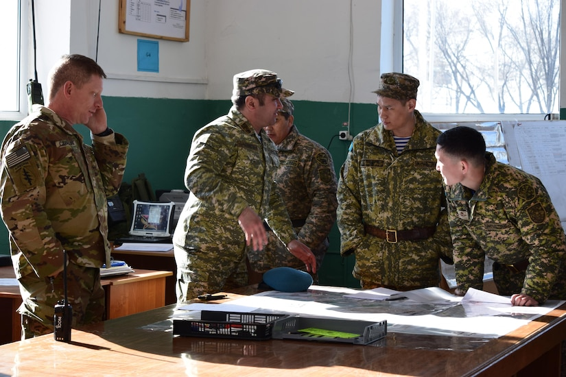 Kazakhstani soldiers with the Kazakhstan Peacekeeping Brigade discuss the practical exercises that occured over the last three days of Steppe Eagle Koktem Apr. 9, 2017, at Illisky Training Center, Kazakhstan. The practical exercises allowed the soldiers with the Kazakhstan Peacekeeping Battalion to demonstrate and further develop the skills they worked on during the military-to-military engagements of the week prior.