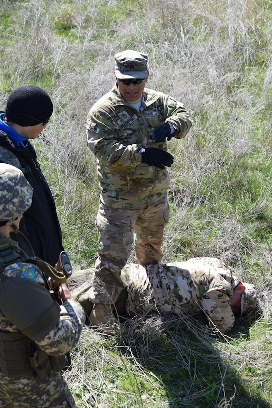 Sgt. 1st Class Javier Martinez, 6th Squadron, 9th Cavalry Regiment, answers questions about searching an enemy casualty during a scenario of the Steppe Eagle Koktem practical exercises Apr. 9, 2017, at Illisky Training Center, Kazakhstan.