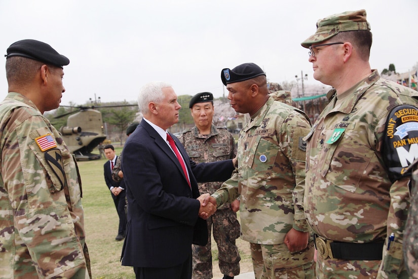Vice President Mike Pence shakes hands with Command Sgt. Maj. Steven L. Payton, senior enlisted advisor for United Nations Command, Combined Forces Command and U.S. Forces Korea, near the Demilitarized Zone in South Korea, April 17, 2017. Pence is on his first trip to South Korea as vice president. Army photo by Sgt. 1st Class Sean K. Harp